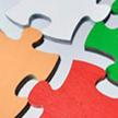 彩色拼图背景新员工入职培训PPT模板